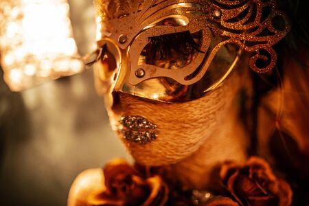 venetian mask on mannequin head in warm lighting