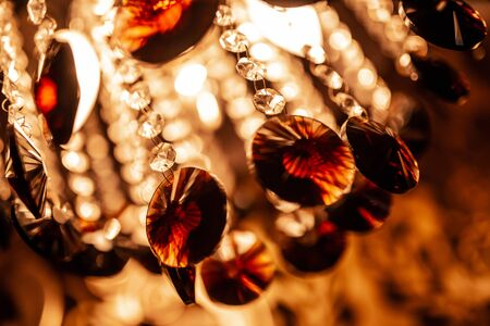 Close up abstract background of unique crystal designs in an interior lighting fixture