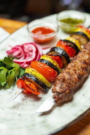 Lamb kebab and Grilled vegetables on a plate close up Zdjęcie Seryjne
