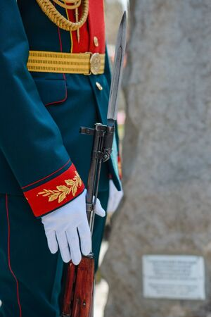 The guard of honor officer in white gloves holds a weapon. Close-up of hands. Victory Day in Russia Stok Fotoğraf
