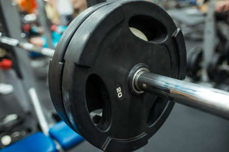 Close-up image of a fitness equipment in gym. Barbell in the gym