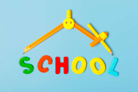 Bright orange compass in the shape of the roof of the house and the word school from multi-colored letters. Home online learning concept. School building concept. Flat lay.