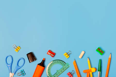 Different school stationery on a blue background. Concept back to school. Study concept. Stationery store concept. Copy space, flat lay, top view.
