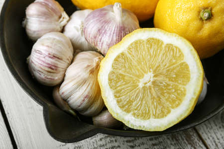 lemon and garlic on a black plate. Vitamin C.