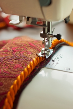 sewing machine needle and decorative edging cord photo