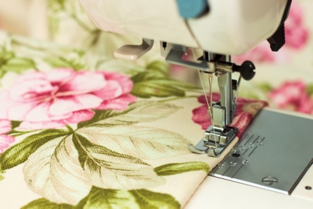sewing machine needle and fabric photo