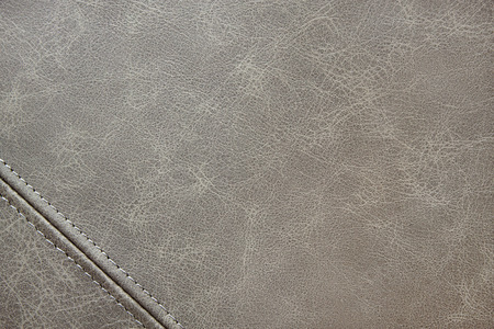 gray leather texture with seam closeup background