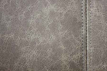 gray leather texture with seam closeup background photo