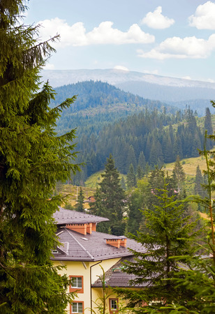 yellow house: yellow house in the Carpathian mountains landscape Stock Photo