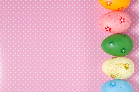 polka dots background: Colorful Easter eggs on polka dots background Stock Photo