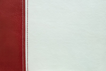 white leather texture: Red and white  leather texture with a  seam Stock Photo