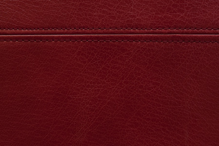 seam: Red leather texture background with a  seam Stock Photo