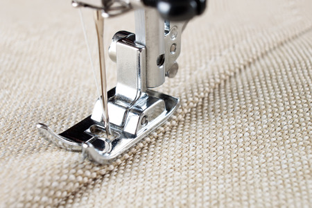 sewing machine makes a seam on fabric. sewing process Stock Photo