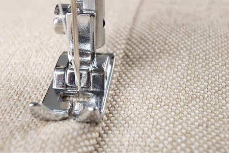 sewing machine makes a seam on fabric. sewing process Stockfoto