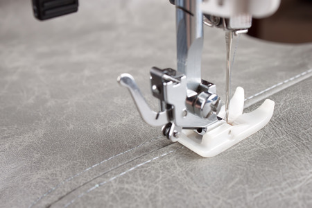 sewing machine makes a seam on leather. sewing process