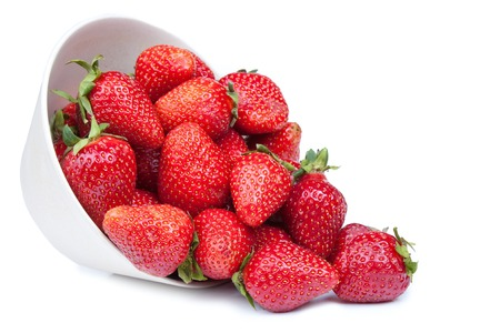 Red fresh strawberry in a bowl isolated on white background