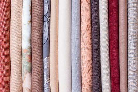 velours: Rolls of colorful velours fabric. textile background