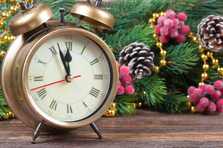 time of the year: New Year clock and fir branch with  red rowan Stock Photo