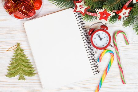 top year: Christmas and New Year background with empty note on white wooden surface. Top view.