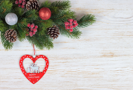 deer in heart: Christmas fir tree with decoration on white wooden board Stock Photo