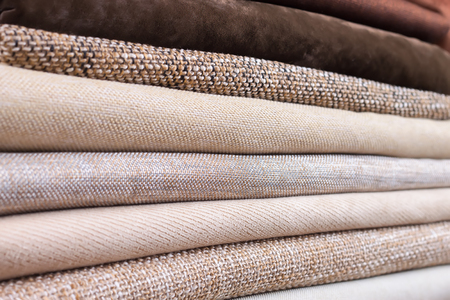 soft sell: Pile of folded colorful textile. Heap of cloth fabric Stock Photo