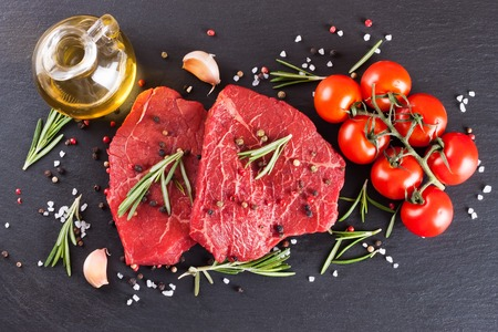 Raw steak with spices and ingredients for cooking. Top view Stock Photo