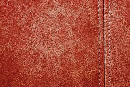 seam: Texture red leather with seam closeup background