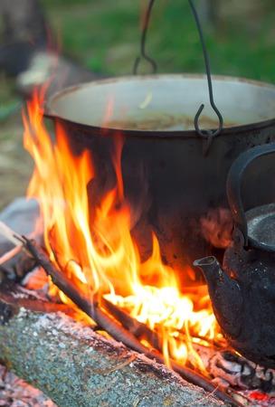 Tourist pot over camp fire Stock Photo