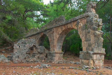 mare agitato: Stone aqueduct in the ancient city of Phaselis. Ancient Phaselis ruins in Turkey Kemer Antalya