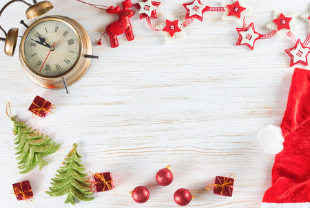 Christmas and New Year holiday background. Christmas decorations on white wooden surface with copy-space. Top view.