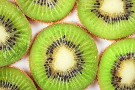 Slice of fresh kiwi fruit isolated on white background. top view. Stockfoto