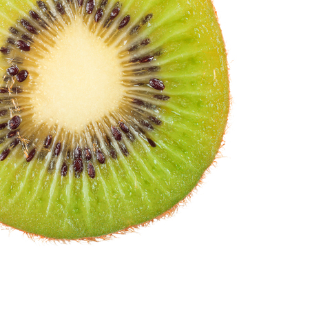 Slice of fresh kiwi fruit isolated on white background. Macro. Stockfoto - 101078368