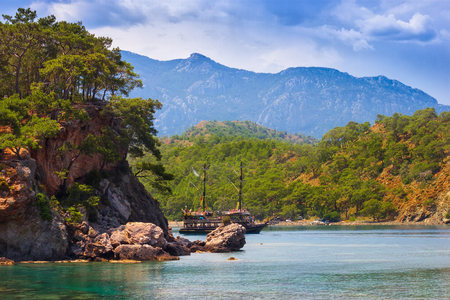 beautiful seascape. summer day in a bay with mountains and a ship. Turkey. Antalya.