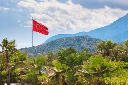 Turkish flag over the sky and mountain view. Antalya, Turkey.