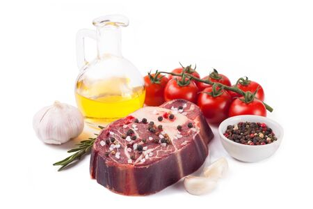 raw meat beef steak with bone, spices, rosemary and cooking ingredients isolated on white background.