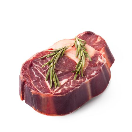 raw beef steak with bone and rosemary isolated over white