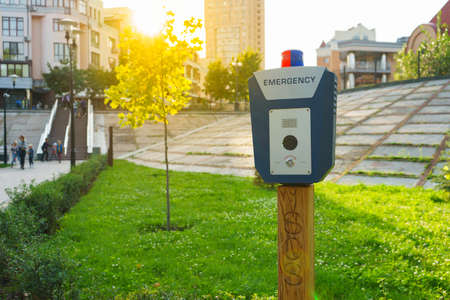Panic alarm, police, emergency button in the public park. Blue box with video camera and red blue warning light on top