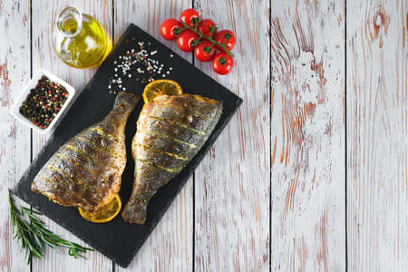 Grilled fish with roasted with lemon and spices