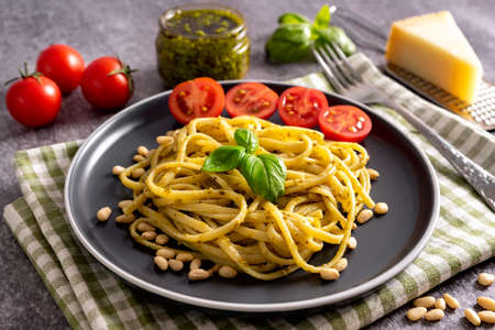 Pasta with fresh homemade pesto sauce and food ingredients