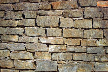 Aged stone wall texture background. antique rock masonry