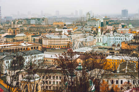 Aerial top view on building roofs of Podil district , Kiev city, Kyiv cityscape, capital of Ukraine