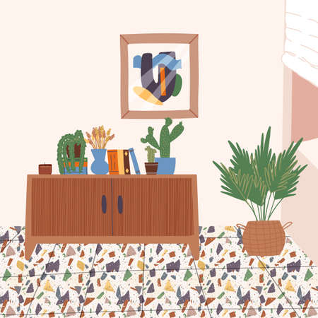 Wooden cabinet on terrazzo floor with various books, a vase with dried grass, potted plants, poster.