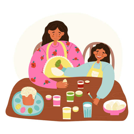 A mother and a daughter Easter pastime scene. Woman teaches her little girl to decorate Easter eggs with food paints.