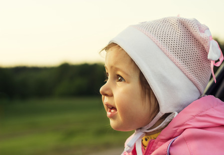 Cute kid thinking at sunset
