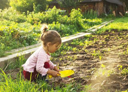 Cute little girl having fun at countryside Stock Photo