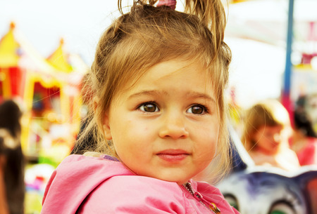 Cute little girl thinking at the park Stock Photo