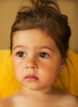 portrait of Cute kid with big sad eyes