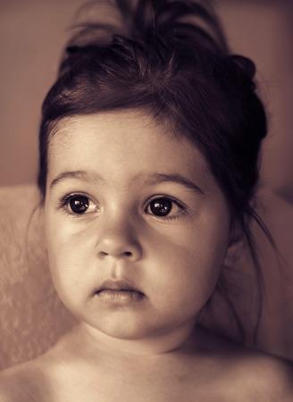 portrait of Cute sad kid thinking, Toned
