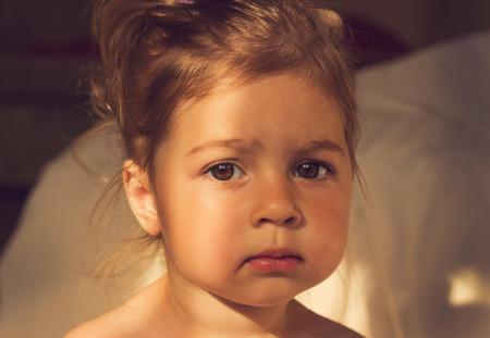 Vintage portrait of Cute kid with big sad eyes Stock Photo