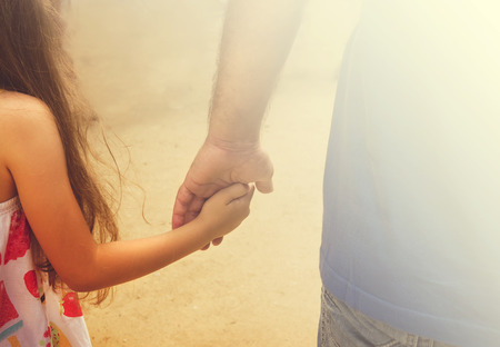 dad and child: Vintage portrait of Father and daughter holding hand in hand in summer day